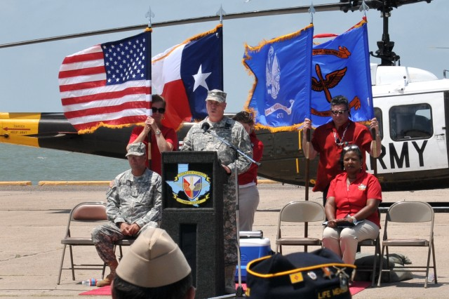 Col. Christopher B. Carlile, Commander, Corpus Christi Army Depot, addresses the crowd gathered to honor the last UH-1H Huey to leave the depot. The UH-1 officially retired by the U.S. Army in May of this year at Fort Rucker's Aviation Center of Excellence. U.S. Army Photo by Ervey Martinez(RELEASED).