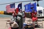 Col. Christopher B. Carlile, Commander, Corpus Christi Army Depot, addresses the crowd gathered to honor the last UH-1H Huey to leave the depot.