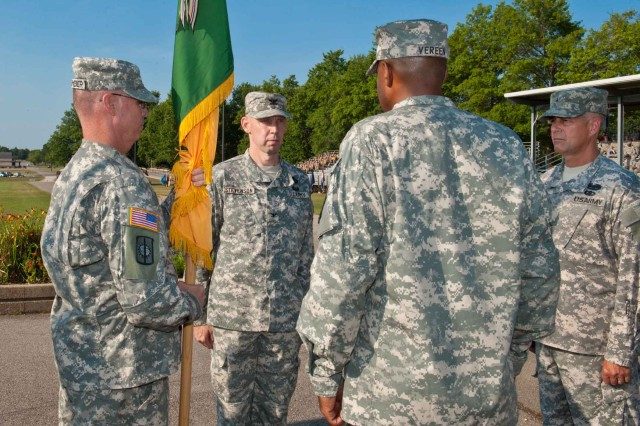 The 14th Military Police Brigade held a change of command, July 22, on Fort Leonard Wood's Gammon Field. Pictured left to right: Command Sgt. Maj. Gerald Stegemeier, 14th MP Brigade regimental command sergeant major, Col. Jerry Stevenson, Brig. Gen. David Phillips, and Col. Kevin Vereen. Army photo/Keith Burkhart