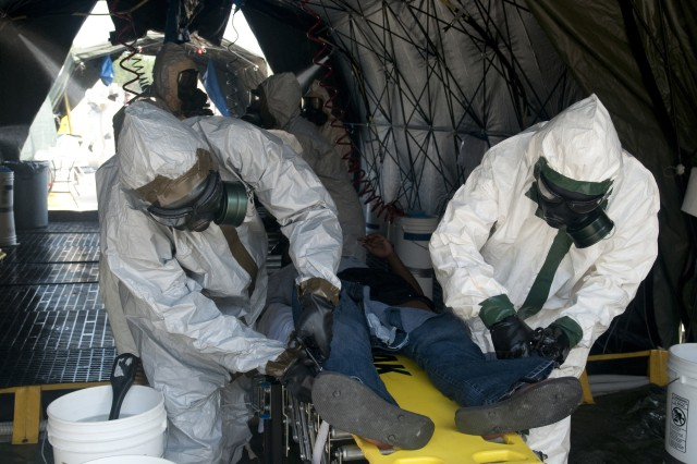 Members of the 101st Chemical, Biological, Radiological and Nuclear Company are trained to handle domestic disasters during a mass casualty decontamination validation class, July 20, 2011, at Fayetteville, N.C., Municipal Airport. The training gives an opportunity to simulate conditions of a potential chemical, biological, radiological or nuclear threat.