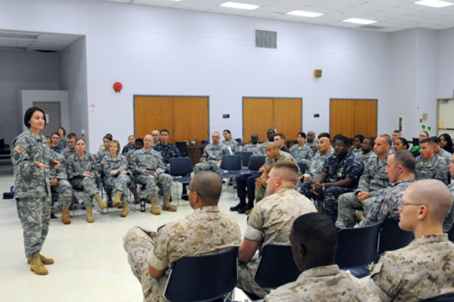 Paralegals from the U.S. Army, Navy, Air Force, Marines and Coast Guard listen to an instructor during a joint service quaterly training event held at Fort Shafter, recently.