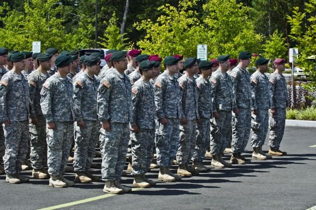 JOINT BASE LEWIS-McCHORD, Wash. – Soldiers from 1st Special Forces Group stand proudly in formation as the Winder Family Clinic is dedicated to one of their fallen comrades June 27.