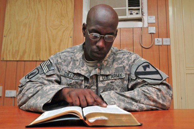 First Lieutenant Jeremy Dillard, a Kansas City, Kan., native, and assistant intelligence officer for 3rd Battalion, 82nd Field Artillery Regiment, 2nd Advise and Assist Brigade, 1st Cavalry Division, reads a verse out of his personal Bible at Joint Base Balad, Iraq, July 26, 2011. Dillard's mother gave him the Bible as a gift prior to his first deployment.