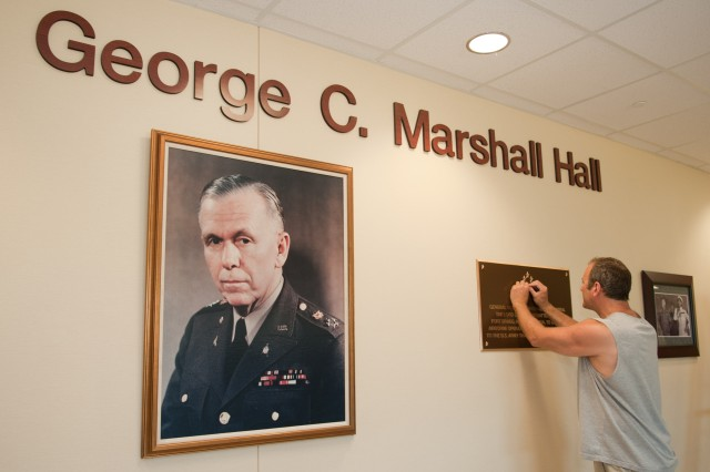 FORT BRAGG, N.C. (July 29, 2011) – Matt Blashfield puts the finishing touches on the Gen. George C. Marshall display at the U.S. Army Forces Command and U.S. Army Reserve Command headquarters complex here. The new headquarters has been named for General of the Army George C. Marshall, Army chief of staff, 1939-1945. A building dedication ceremony that will include the uncasing of both commands' colors will be held Aug. 1.