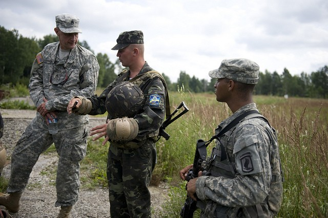 U.S. paratroopers from the 173rd Airborne Brigade Combat Team out of Vicenza, Italy, train with Ukrainian Paratroopers at the International Peacekeeping and Security Center in Ukraine as part of Exercise Rapid Trident 2011. Rapid Trident is a multi-national airborne operation and field training exercise in support of Ukraine's Annual Program to achieve interoperability with NATO.