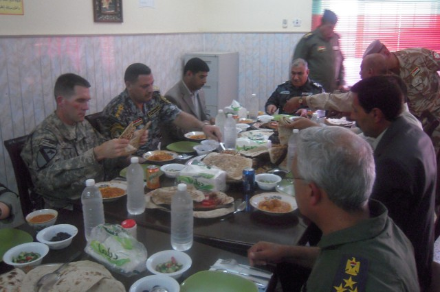 CONTINGENCY OPERATING BASE DELTA, Iraq - Brig. Gen. Abdul Kareem, deputy commander of Al-Kut Air Force Base, was joined by a party of commanders for lunch at the dining facility inside the Iraqi Compound on Contingency Operating Base Delta July 14, 2011.  Kareem's personal chef cooked fresh fish, chicken, and Iraqi rice for everyone. This is the first time this group of influential leaders from the Wasit province, have met to discuss coordination.