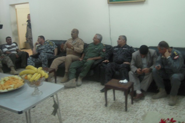 CONTINGENCY OPERATING BASE DELTA, Iraq - Brig. Gen. Abdul Kareem, deputy commander of Al-Kut Air Force Base, was joined by a party of commanders inside the Iraqi compound's Morale, Welfare, and Recreation room to enjoy servings of fresh fruit and more discussion of Iraqi joint security efforts July 14, 2011.  This meeting included some of the most influential leaders in Al-Kut and Wasit province.  The intent of the meeting was to show the Iraqi ground force and intelligence commanders the capabilities of the Iraqi Air Force, so that they may use it as an asset in the future.