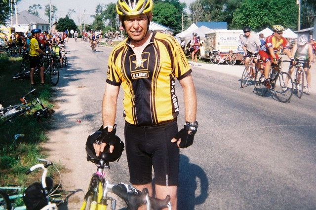 Command Sgt. Maj. Stephen Blake of Army Sustainment Command takes a break on the last leg of a bicycle ride across Iowa.