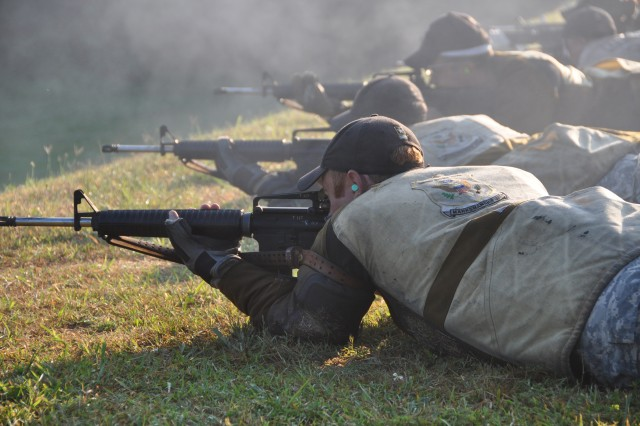 Staff Sgt. Joel Micholick, U.S. Army Marksmanship Unit, fires his service rifle during the 50th Interservice Rifle Championship July 26, 2011. Micholick set a new match record in the 1,000 yard aggregate with the service rifle, a record that had been standing since 1984.