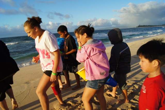 Children of wounded warriors and children who have lost a parent or sibling partake in beach activities on Oahu's North Shore in Hawaii during an Operation Military Kids and Survivor Outreach Service-sponsored weekend retreat at Camp Erdman in Waialua, Hawaii.