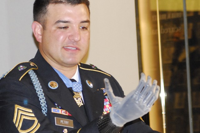 Sgt. 1st Class Leroy Petry shows his prosthetic hand Monday during an interview at the National Infantry Museum at Fort Benning, Ga.