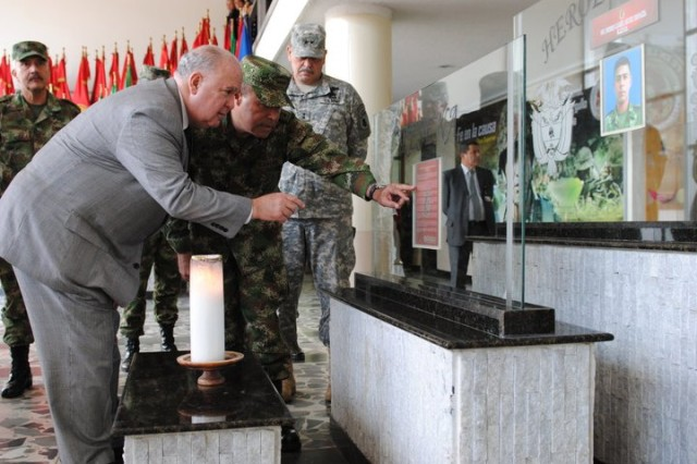 Gen. Alejandro Navas explains the importance of the Fallen Soldier Memorial inside the Colombian army headquarters to Under Secretary of the Army Joseph W. Westphal July 28, 2011. Each week the Colombian army honors a soldier who has died in combat.