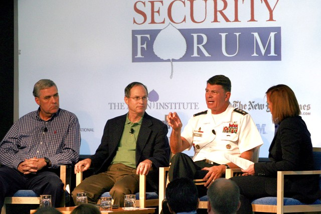 """Lt. Gen. Guy Swan III, commanding general, U.S. Army North, speaks to a packed house of influential attendees July 29 during the Aspen Security Forum at the Aspen Institute in Aspen, Colo. The forum provided him an opportunity to discuss Army North's mission, as well as how it supports U.S. Northern Command and the Department of Defense, with an audience that may not otherwise have visibility on the command's talents and resources. Swan attended the event and was the member of a 3-person panel discussion titled: """"The war abroad and the threat at home."""" He was joined on the panel by retired Lt. Gen. Douglas Lute (left), who serves as a special assistant to the President for Afghanistan and Pakistan, along with Dr. Paul Stockton, the assistant secretary of defense for Homeland Defense and Americas' Security Affairs, Department of Defense. Kimberly Dozier, from the Associated Press, served as the panel moderator."""
