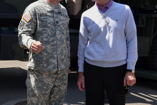 During Secretary of the Army John McHugh's Aug. 2, 2011, visit to Rhine Ordnance Barracks, Germany, Staff Sgt. Rusty Bailey, a master gunner from Battery A, 5th Battalion, 7th Air Defense Artillery, had the chance to brief McHugh on how Patriot batteries set up.