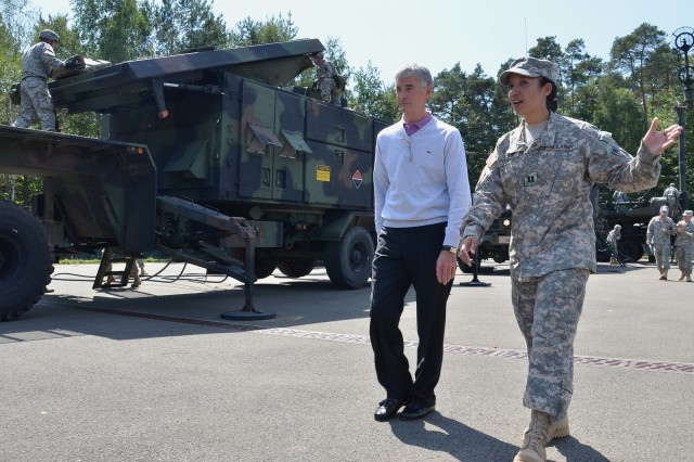 Capt. Alissa Clark, commander of Battery A, 5th Battalion, 7th Air Defense Artillery, explains her unit's mission to Secretary of the Army John McHugh, during his Aug. 2, 2011, visit to Rhine Ordnance Barracks, Germany.