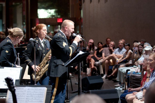 """MANHATTAN-- The 42nd Infantry Division Band's rock Musical Performance Team """"Three Day Pass"""" performs for spectators at Lincoln Center , the famed theater in New York City on July 28. The New York Army National Guard Band is the Army's musical ambassador to New York's cities and villages."""