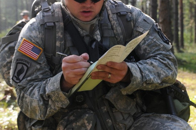 Spc. Alex Hughes, 173rd Brigade Support Battalion, a candidate at the 2011 U.S. Army Europe Expert Field Medical Badge Standardization and Testing records information during a run-through of Combat Testing Lane 2 Aug. 3, 2011 at the Grafenwoehr Training Area, Germany. (U.S. Army photo by Spc. Mary Hogle)