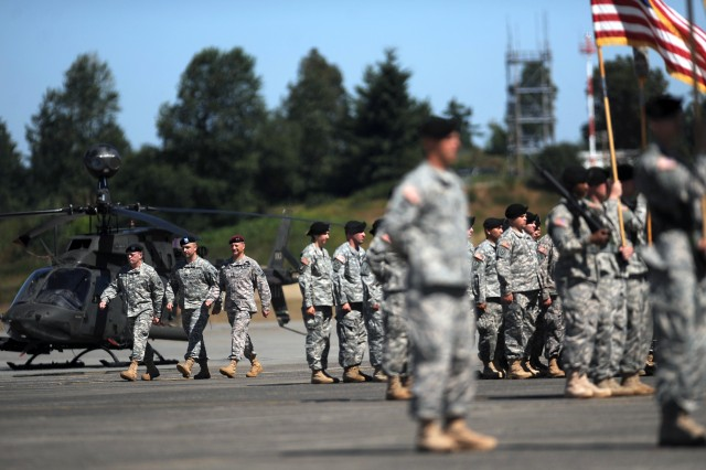 Col. Robert Werthman, left, Lt. Col. James Faulknor, and Maj. Gen. Raymond Palumbo inspect the 16th CAB troops Aug. 1 during a change of command and activation ceremony at Gray Army Airfield. The aviation brigade relocated from Ft. Wainwright, Alaska to JBLM.