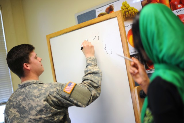 Spc. William Bradley, left, B Co., 1-17 Inf., receives instruction July 29 during a Pashto lesson at the Foreign Language Training Center on JBLM.