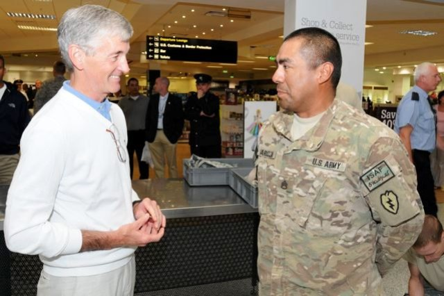 "Secretary of the Army John McHugh speaks with Staff Sgt. Paul Barboza, Brigade Troops Battalion, 25th Stryker Brigade, Fairbanks, Alaska, Aug. 5, during a layover at Shannon Airport, Ireland.  Barboza, who is redeploying from Afghanistan, spoke to McHugh shortly after landing.  McHugh has signed a directive instituting a 9-month ""boots on the ground"" policy for deployed Soldiers, providing more ""dwell"" time at home for Soldiers and Families."