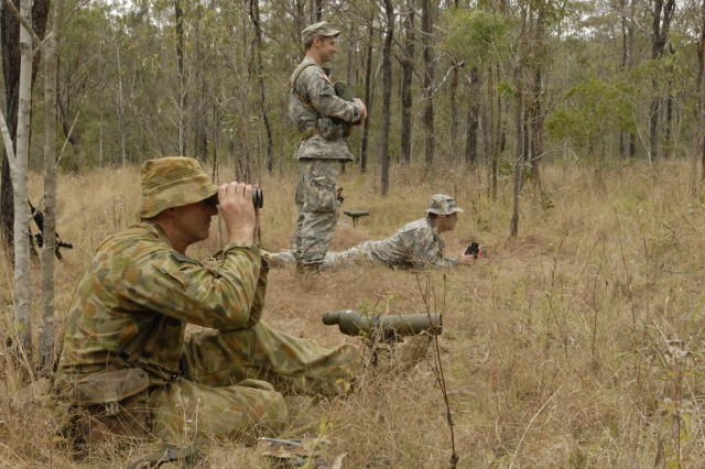 Australian Defence Force Pvt. Neal Cullinan scans a field littered with ten hidden items during a training exercise administered by the Maryland Army National Guard's Charlie Troop, 1st Battalion, 158th Cavalry Squadron, during Exercise Talisman Sabre activities at the Shoalwater Bay Training Area, Australia, July 17, 2011.