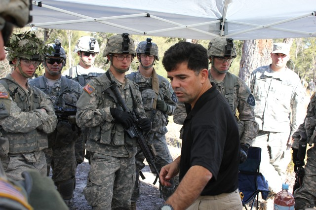 Soldiers from Company A, 2-23 Infantry, 2nd Infantry Division listen inventively as Terry Perez, instructor with the Asia Pacific Counter IED Fusion Center, shows replicas of enemy homemade explosive devices. The counter IED training was part of Exercise Talisman Saber, Shoalwater Bay, Australia.
