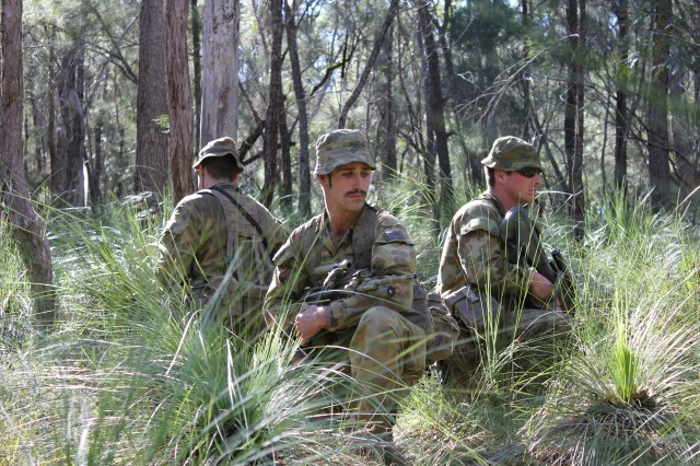 Soldiers from the 5th RAR, Australian Defense Force, pause during a patrol during counter IED training at Talisman Saber, Shoalwater Bay, Australia.