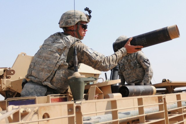 CONTINGENCY OPERATING BASE WARHORSE, Iraq – Mortarmen with Headquarters and Headquarters Company, 1st Battalion, 8th Cavalry Regiment, 2nd Advise and Assist Brigade, 1st Cavalry Division, clear empty mortar round cases after conducting a five-round mortar fire during a training exercise near Contingency Operating Base Warhorse, Iraq, July 23, 2011.