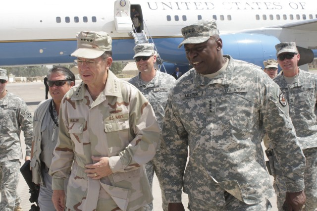 CONTINGENCY OPERATING SITE MAREZ, Iraq – Chairman of the Joint Chiefs of Staff, Adm. Mike Mullen, left, and Gen. Lloyd Austin, commander of U.S. Forces – Iraq, land at Contingency Operating Site Marez, Iraq, Aug. 1, 2011. Mullen and Austin met with senior U.S. Division – North leadership to discuss security in northern Iraq during a tour of the Ninewa Combined Coordination Center.