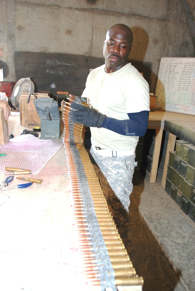 A Soldier inspects ammunition that has been turned in.