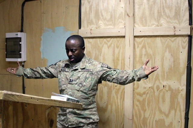 CAMP KUNDUZ, Afghanistan – Cpt. Emmanuel Woods, chaplain, Task Force Guns, 1st Air Cavalry Brigade, 1st Cavalry Division, concludes his sermon during a non-denominational church service July 31. Woods takes an energetic approach to his sermons as he speaks of the importance of spiritual resilience to those in attendance. Woods immigrated to the United States as a refugee after he had flung his native land: war-torn Liberia in the 1990s.