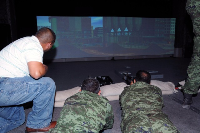 Senior Mexican Army leaders try their hands with U.S. Army weapons at the Engagement Skills Trainer on Fort Hood, Texas, June 15, 2011, as part of the Fifth Army Inter-American Relations Program, a program that dates back to 1946. The EST provides realistic marksmanship and combat scenario training for 12 of the most common small arms and crew-served weapons and individual anti-tank weapons in the Army inventory, and includes multi-lane individual and collective gunnery training for static, dismounted individual, squad, team and element levels.