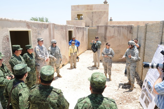 Senior Mexican Army leaders get a breakdown of the training being conducted by U.S. Army Soldiers from the 104th Engineer Company, 62nd Engineer Battalion, at Fort Hood, Texas, June 15, 2011, in one of the mock compounds in Fort Hood's training areas, as part of the Fifth Army Inter-American Relations Program, a program that dates back to 1946.