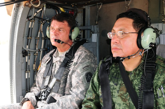 Lt. Gen. Guy Swan III, commanding general, U.S. Army North and Fort Sam Houston, and Mexican Army Maj. Gen. Jaime Lopez Reyes, look out over Camp Swift, Texas, during a helicopter flight June 16, 2011.