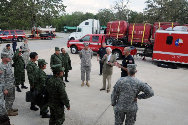Members of Texas Task Force 1, the state's urban search and rescue unit, brief senior Mexican Army leaders on the unit's vehicles, equipment and capabilities during a tour at College Station, Texas, June 17, 2011, as part of the Fifth Army Inter-American Relations Program.