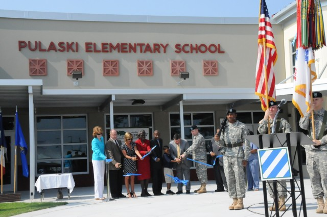 The ribbon is cut, officially opening the new Pulaski Elementary School, a public school built on Department of Defense land on Hunter Army Airfield, Ga., Aug. 8, 2011.