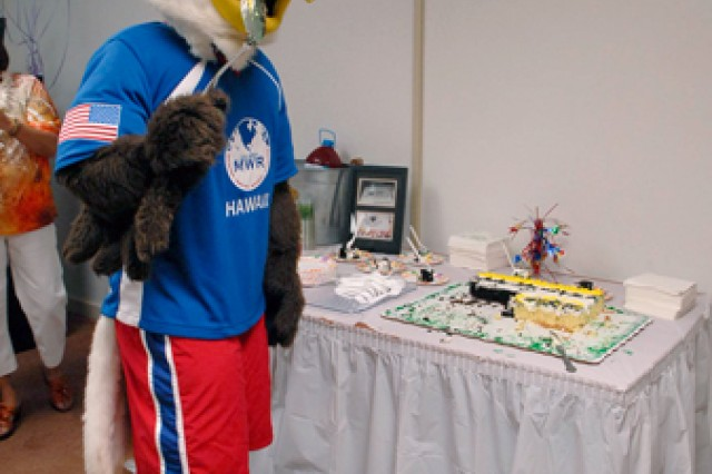 Eddie the Eagle, the official mascot of USAG-Hawaii's Directorate of Family and MWR, flew in to pick through some ACS birthday cake, July 29.