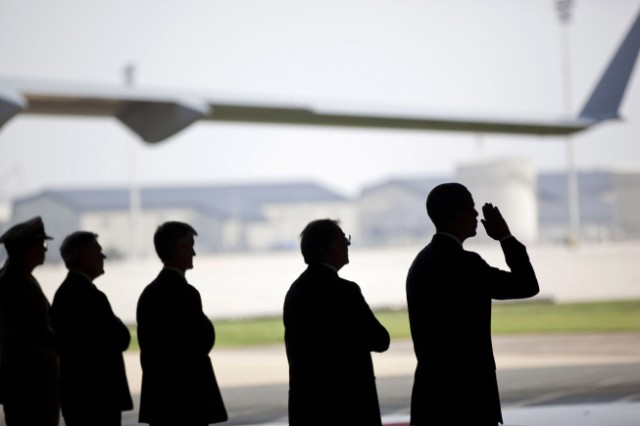 President Barack Obama, in the process of saluting, participates in a ceremony at Dover Air Force Base in Dover, Del., Aug. 9, 2011, for the dignified transfer of U.S. and Afghan personnel who died in Afghanistan on Aug. 6, 2011.