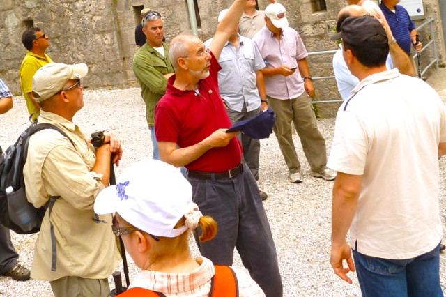 Prof. Paolo Pozzato (center) describes World War I Italian artillery fire at the former Austrian Fort Kluze, near Koberid, Slovenia, during the U.S. Army Africa staff ride that focused on montane trench warfare.