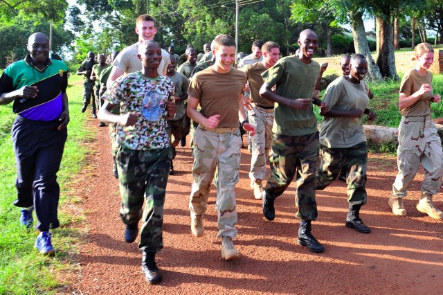 Cadets from the U.S. Military Academy at West Point and midshipmen from the U.S. Naval Academy in Annapolis run with members of the Ugandan People's Defense Force during a formation run at the Jinja Cadet School, Jinja, Uganda.