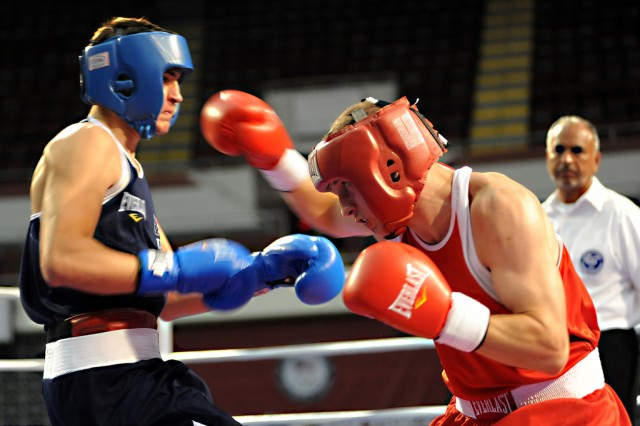 U.S. Army World Class Athlete Program boxer Spc. Samuel Vasquez (right) of Fort Carson, Colo., throws a right hand at Bryant Parrella of Lehigh Acres, Fla., en route to an 18-10 victory in the 152-pound challengers bracket semifinals of the U.S. Olympic Team Trials for Men's Boxing Aug. 3 at the Mobile Civic Center in Mobile, Ala.