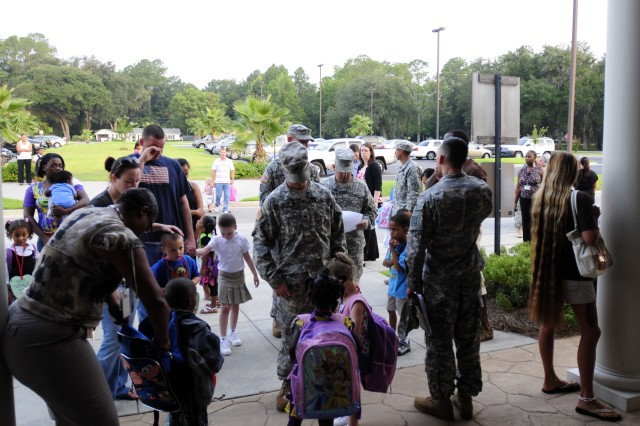 Soldiers and Families prepare their kids for school at Liberty County Pre-K, Aug. 4. Soldiers from 2/7th Inf. helped escort kids that were dropped off to their classrooms and breakfast.