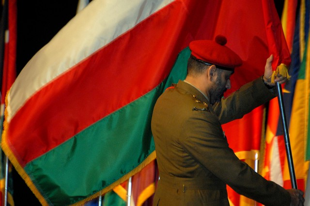 International Intermediate Level Education student Maj. Said Salim Khalifin Al Shekaili posts Oman's flag during the Command and General Staff College international flag ceremony to begin the 2012-01 ILE session Aug. 8 at the Lewis and Clark Center, Fort Leavenworth, Kan.