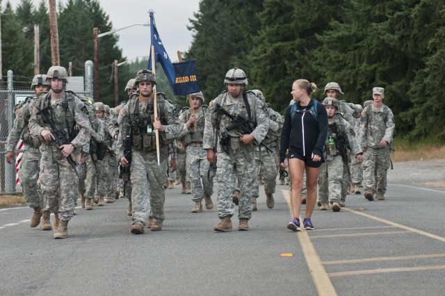 Bravo Company, 4th Battalion, 9th Infantry Regiment, 4th Stryker Brigade Combat Team, 2nd Infantry Division, honored their forefathers by conducting the Manchu Mile road march at Joint Base Lewis-McChord, Wash., Aug. 9-10. Participants in the 25 mile road march consisted of Soldiers from 4-9 Inf., 4-2 SBCT, and a few family members. The ruck honors those who marched 85 miles across China during the Boxer Rebellion, July 1900. (Photo by Spc. Hannah Frenchick, 20th Public Affairs Detachment)