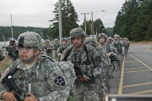 Bravo Company, 4th Battalion, 9th Infantry Regiment, 4th Stryker Brigade Combat Team, 2nd Infantry Division, honored their forefathers by conducting the Manchu Mile road march at Joint Base Lewis-McChord, Wash., Aug. 9-10. The road march gives present Soldiers a taste of what the Manchus during the Boxer Rebellion in 1900 went through. (Photo by Spc. Hannah Frenchick, 20th Public Affairs Detachment)