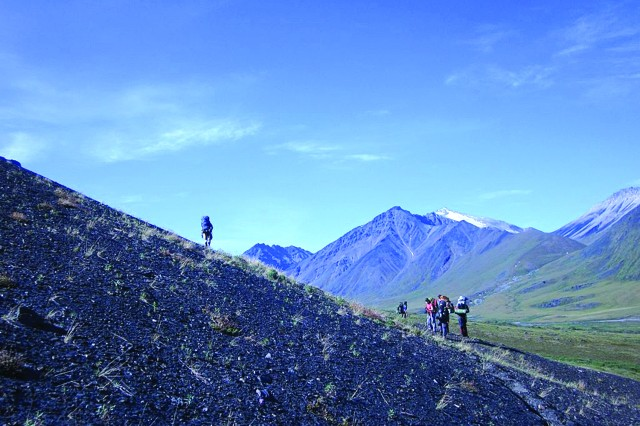 FORT WAINWRIGHT, Alaska - Backpackers on a trip to the Brooks Range with Outdoor Recreation climb the next hill.