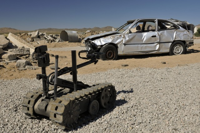 Engineers from the 18th Engineer Company, 2nd Battalion, 3rd Infantry Regiment, 3rd Stryker Brigade Combat Team, 2nd Infantry Division, deploy a robot to search for improvised explosive devices at the National Training Center, Calif., Aug. 10, 2011.  The robot can identify and destroy IEDs 300 meters away from the Soldiers operating it. This technology saves Soldiers from physically having to identify IEDs and keeps Afghan neighborhoods secure.