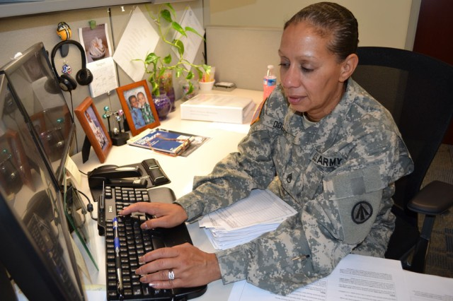 Staff Sgt. Isabel Martell-Dozier, assigned to Military Surface Deployment and Distribution Command's communications directorate, inputs into an electronic spreadsheet data for communications equipment permanently assigned to various Headquarters SDDC personnel. Martell-Dozier is responsible for maintaining accountability of all temporarily- and permanently-assigned Headquarters SDDC communications equipment, including desktop and laptop computers, cameras, printers, scanners, and more.