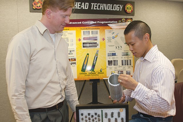Picatinny Arsenal engineers Peter Rottinger (left) and Henry Hsieh examine a design concept for projectile fragments that are more consistent in size.
