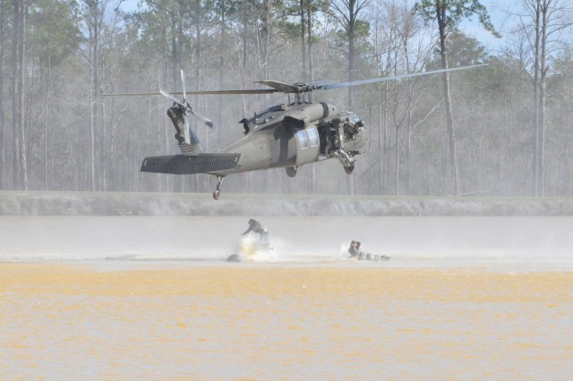 """FORT BENNING, Ga. -- Ranger Instructors from the 4th Ranger Training Battalion helo-cast into Victory Pond during """"Rangers in Action."""" The demonstration will take place March 16 as part of the 2012 Army Strong Experience. (Photo by Michael Molinaro, USAMU PAO)"""